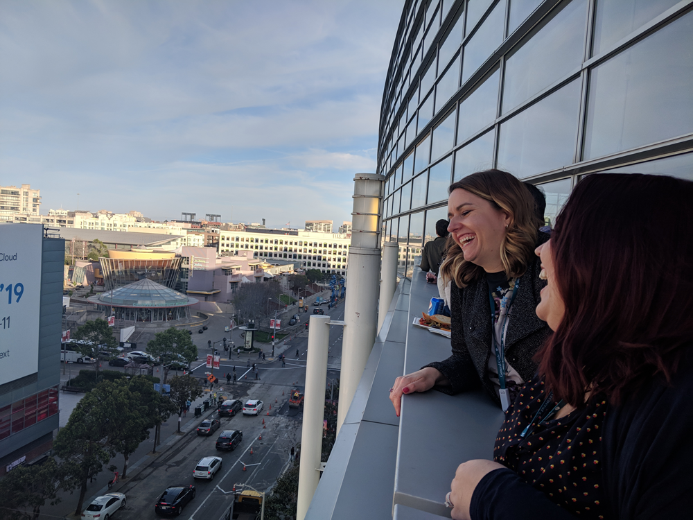 Genevieve Federighi and Victoria Lombardo, AICP, from Tracy, California, enjoy the San Francisco sunset at the Welcome Reception. Photo by Molly Walsh.