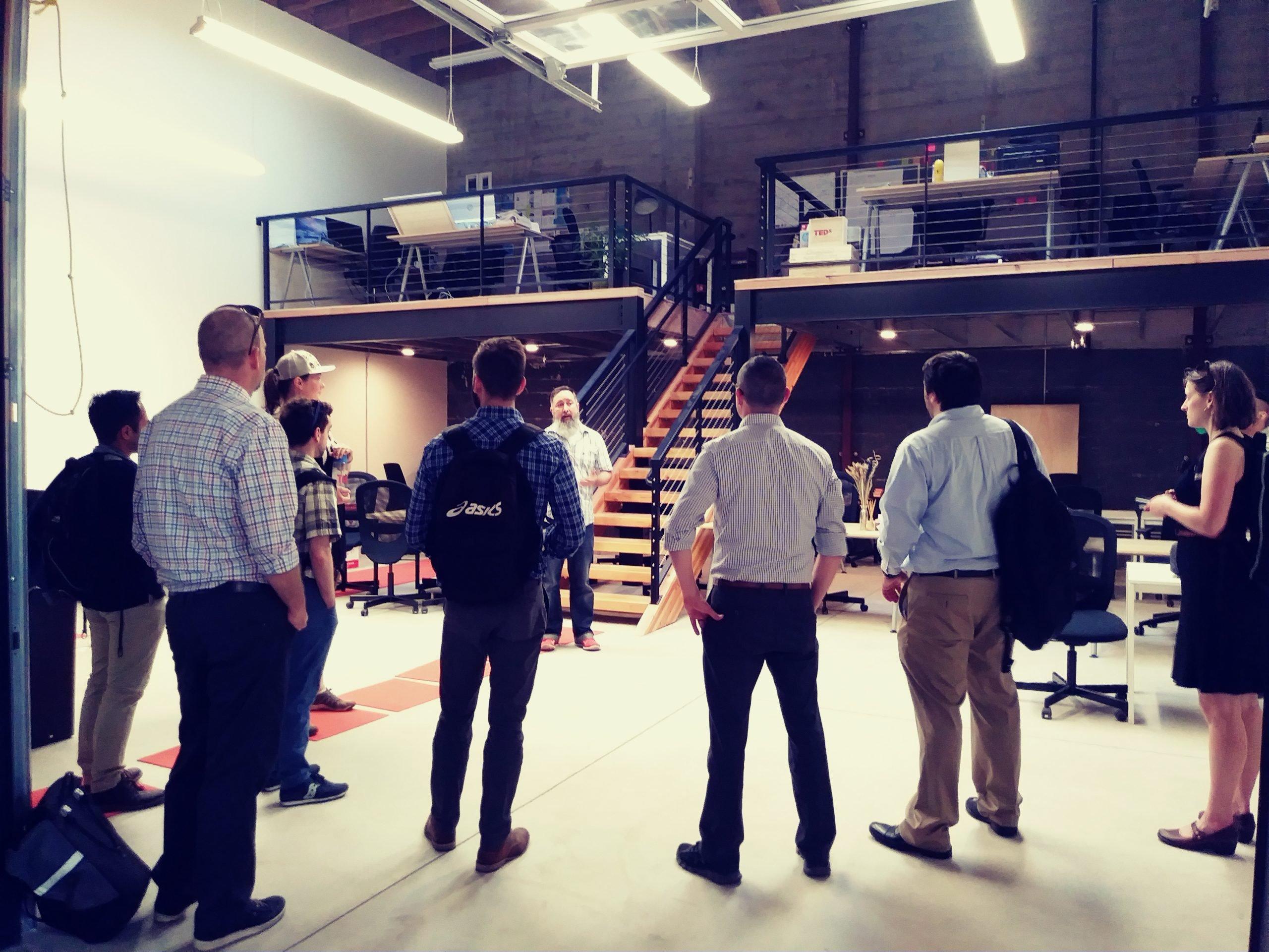 Group of mentorship participants on a site tour