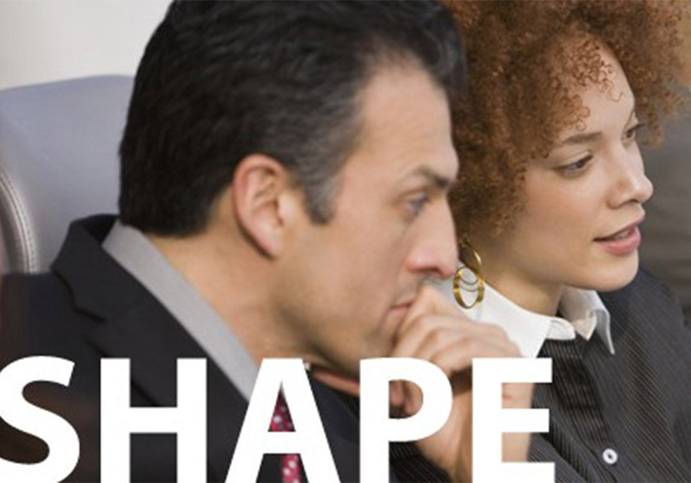 Photo depicting man and woman sitting side by side considering something.