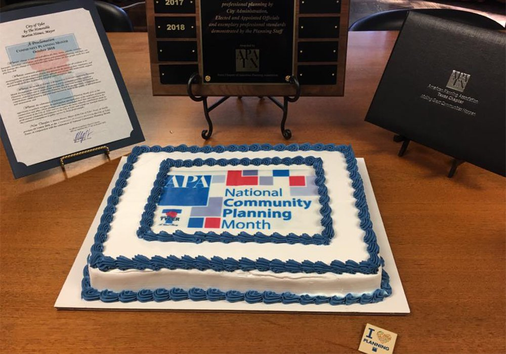 Photo depicting NCPM-themed cake on desk in Tyler, Texas.
