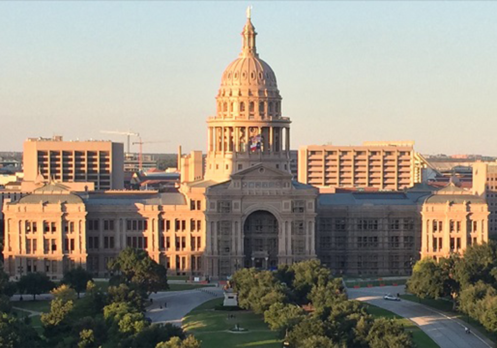Image depicting the Austin capitol in afternoon or evening light.